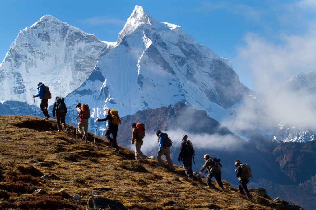Soldiers to the Summit team trekking above Pherich in the shadow of Ama Dablam. Photo by Didrik Johnck